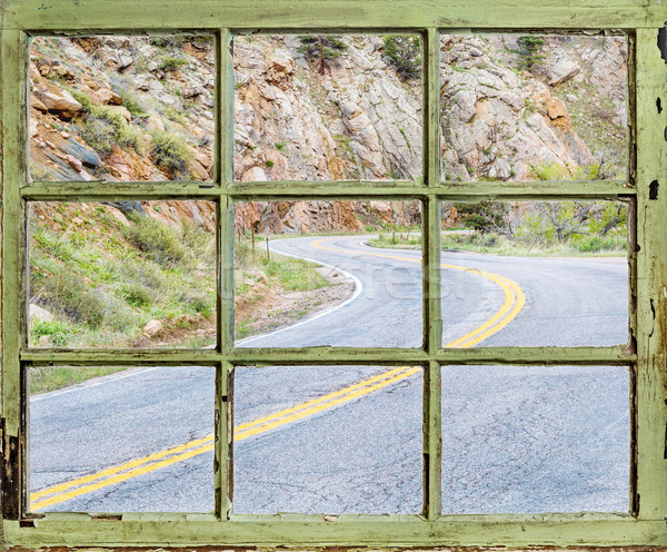 travel concept - windy road through old window Stock photo © PixelsAway