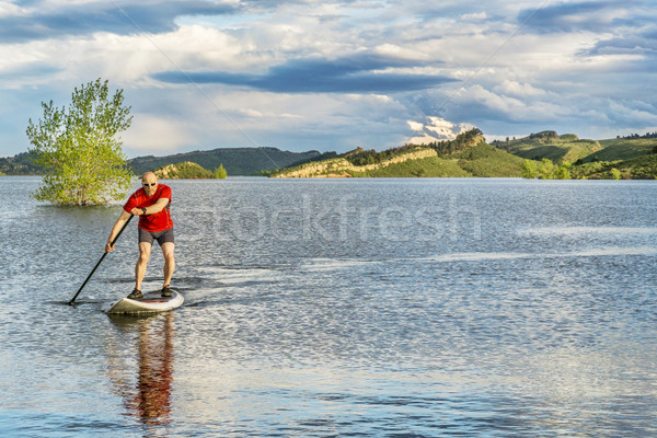 senior male SUP paddler on lake Stock photo © PixelsAway