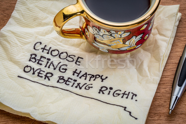 Stock photo: Choose being happy reminder on napkin