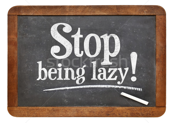 Stop being lazy - blackboard sign Stock photo © PixelsAway
