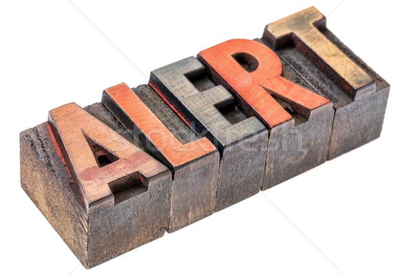 alert word in vintage wood type Stock photo © PixelsAway