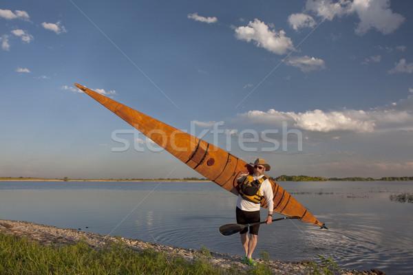 paddler with wooden sea kayak Stock photo © PixelsAway