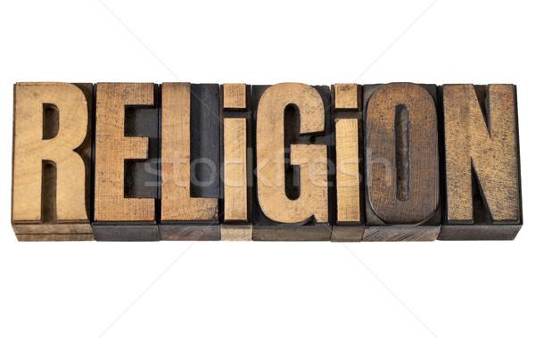 religion word in vintage wood type Stock photo © PixelsAway