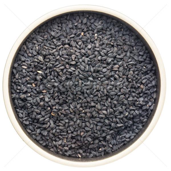 Zwarte komijn zaden keramische kom geïsoleerd Stockfoto © PixelsAway