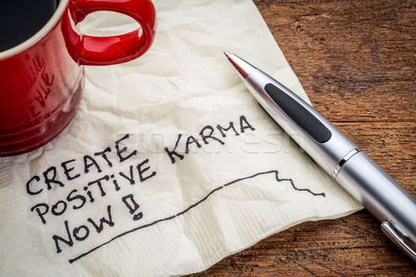create positive karma - text on napkin Stock photo © PixelsAway