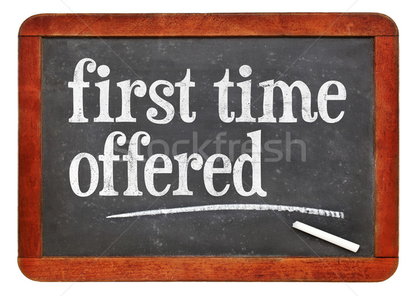 first time offered blackboard sign Stock photo © PixelsAway