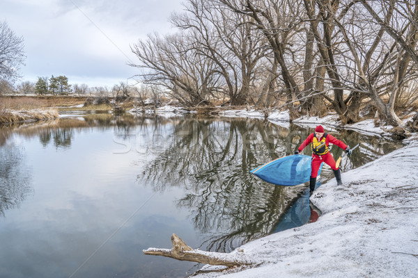 winter stand up paddling Stock photo © PixelsAway