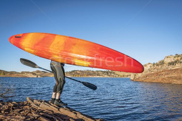 kayak portaging on lake shore Stock photo © PixelsAway
