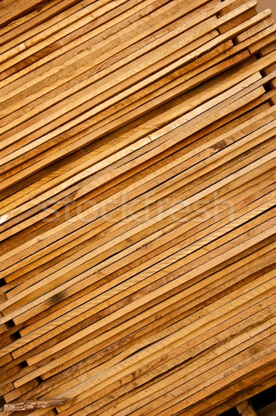 Stack of Rough Cut Wood Lumber on Angle Stock photo © pixelsnap