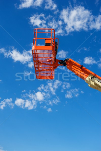 Vertical Shot of an Orange Hydraulic Construction Lift Stock photo © pixelsnap