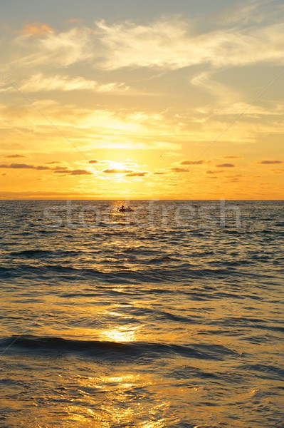 Small Boat at Sunset Over the Pacific Ocean Stock photo © pixelsnap