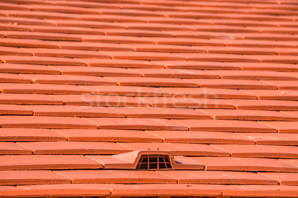 A roof under construction with stacks of roof tiles ready to fasten Stock photo © pixinoo
