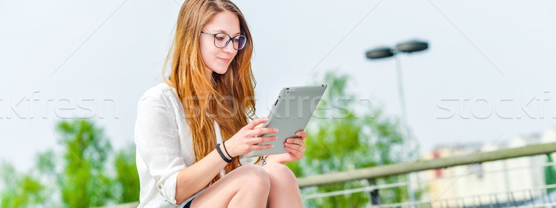 executive girl working on a touchscreen tablet Stock photo © pixinoo