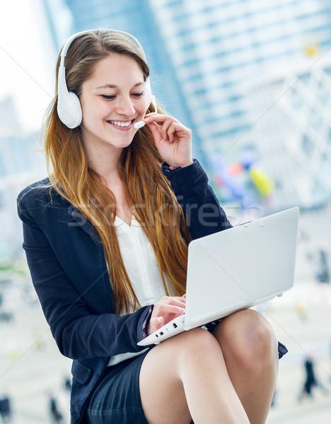 Blonde support operator in headset outdoor Stock photo © pixinoo