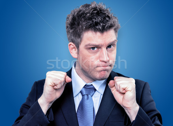 Businessman Clenching Fists To Motivate Team In Office Stock photo © pixinoo