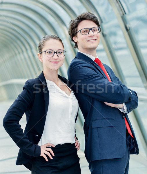 Stock photo: business partners posing back to back
