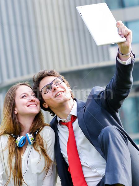 Fiatal üzlet pár készít fotó tabletta Stock fotó © pixinoo