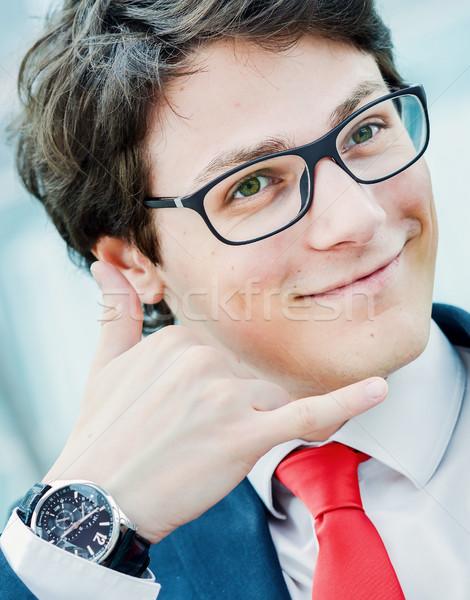 Fiatal üzletember gesztikulál hívás telefon készít Stock fotó © pixinoo