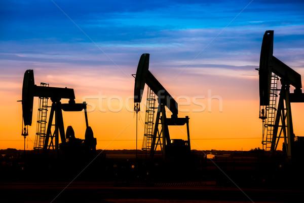 Silhouette pétrolières domaine coucher du soleil ciel Nice Photo stock © pixinoo