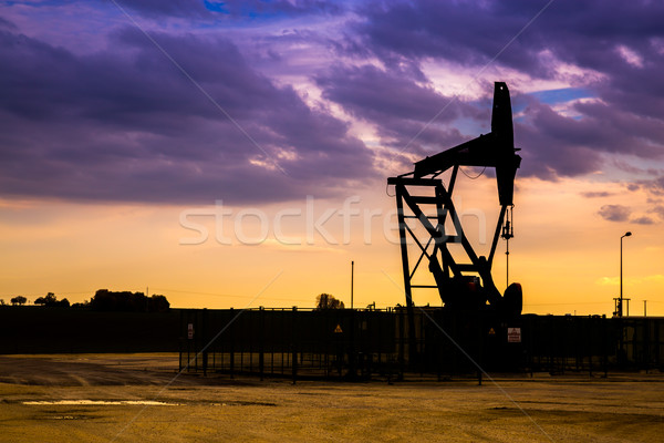 Silhouette of Oil pumps at oil field with sunset sky background Stock photo © pixinoo