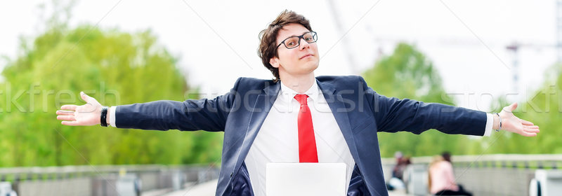 dynamic young executive working outside Stock photo © pixinoo