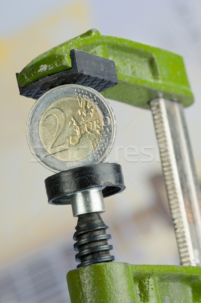 Euro coin in a clamp Stock photo © pixpack