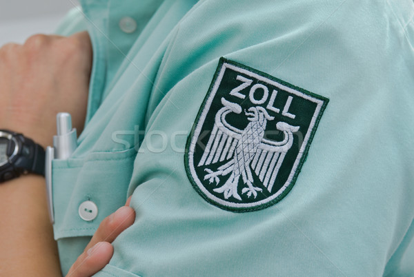 Label douane officier shirt controleren Stockfoto © pixpack