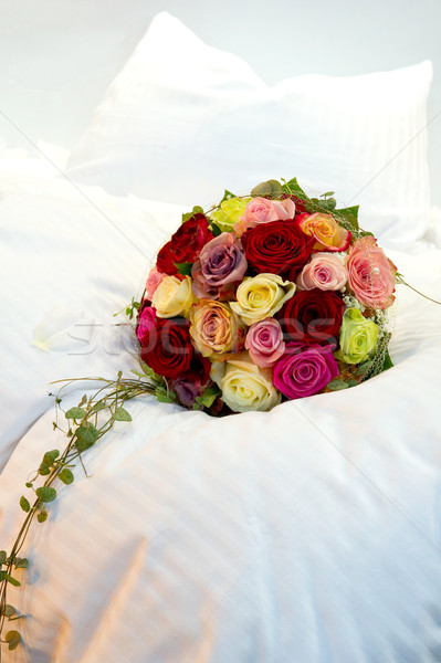 Bridal bouquet on a bed Stock photo © pixpack