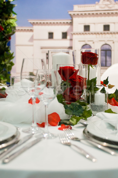 Covered banquet with red roses decoration Stock photo © pixpack