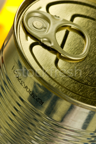 Aperture ring on a gold-colored tin Stock photo © pixpack