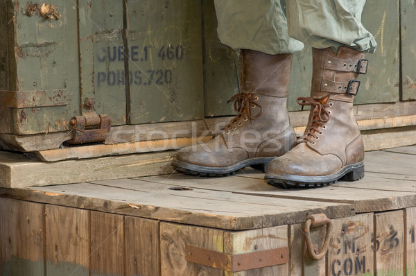 Soldiers boots in a military storage depot Stock photo © pixpack