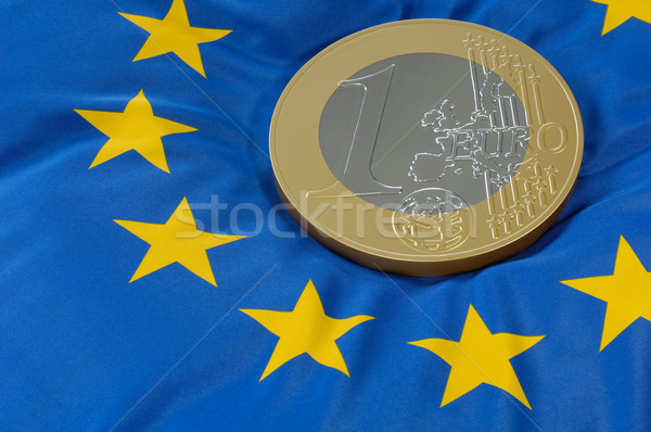 Euro coin on a european flag Stock photo © pixpack
