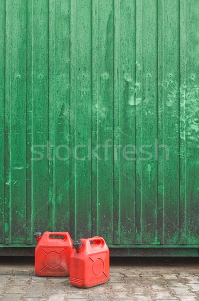 Dwa czerwony benzyny zielone pojemnik ściany Zdjęcia stock © pixpack