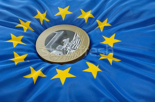 Euro coin on a european flag Stock photo © pixpack