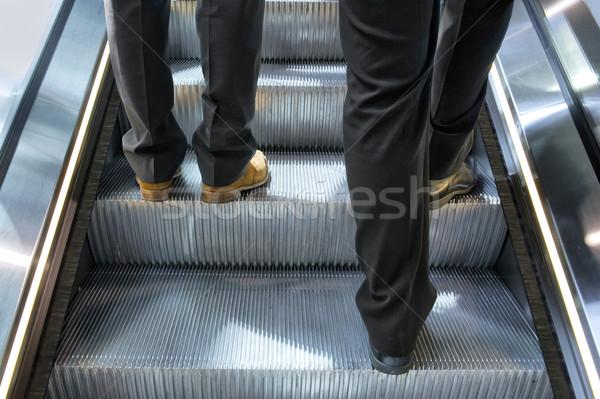 Due uomini scala mobile uomini gambe fase trasporto Foto d'archivio © pixpack