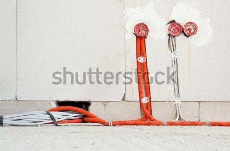Elektryczne instalacja budowy pomarańczowy cegły elektryczne Zdjęcia stock © pixpack