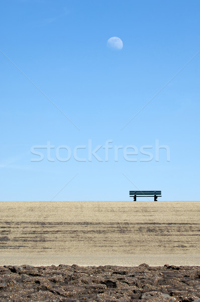 Lonely bench on a concrete dyke Stock photo © pixpack