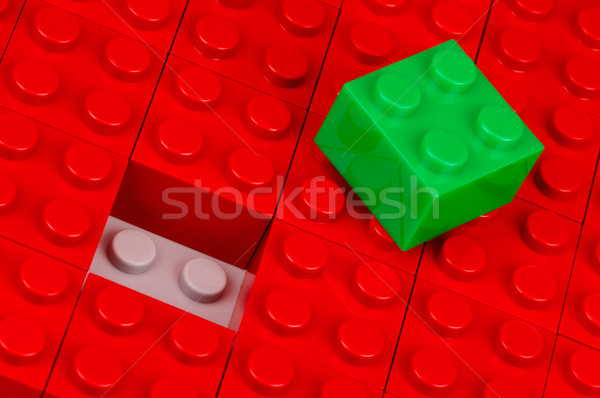 Green building block on red one Stock photo © pixpack