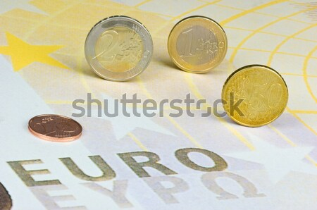 Euro coins rolling over a newspaper Stock photo © pixpack