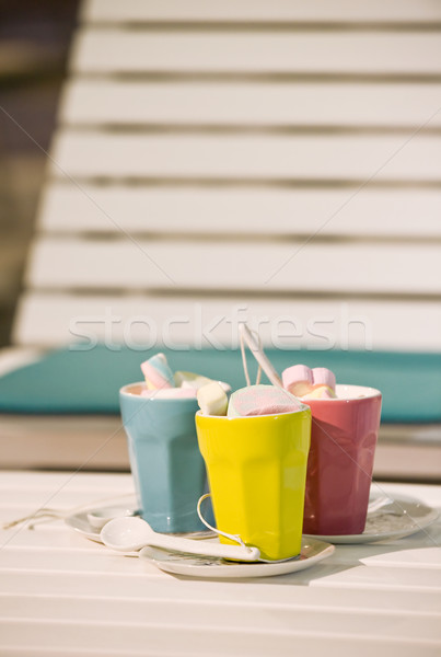 Three cups on a  sunbed Stock photo © pixpack