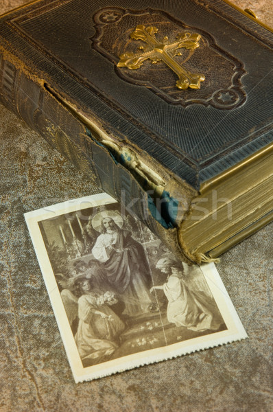 Old bible with picture of saints Stock photo © pixpack