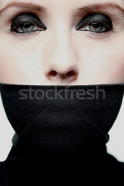 Young woman with covered mouth Stock photo © PiXXart