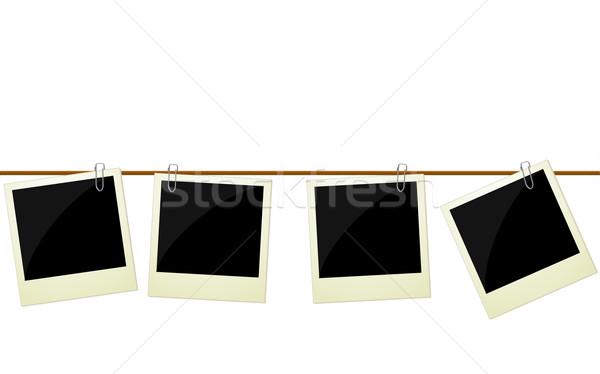Four polaroid photos hanging on rope Stock photo © PiXXart