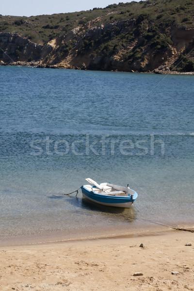 Piccolo barca spiaggia mare Ocean sunrise Foto d'archivio © PiXXart