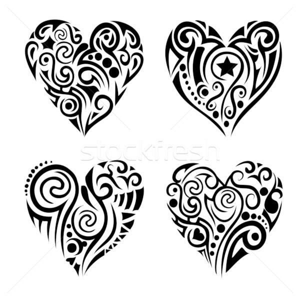 Tribel hearts Stock photo © PiXXart