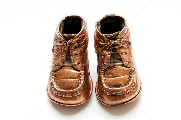 Bronze baby shoes Stock photo © PiXXart
