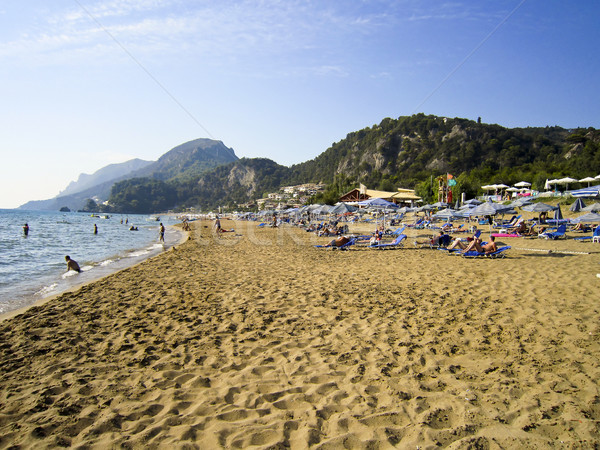 Glifada beach crowded with tourists Stock photo © PiXXart