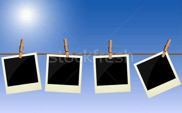 Four polaroid pictures hanging on rope against bright sky Stock photo © PiXXart