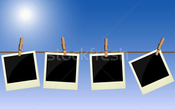 Dört kutuplayıcı resimleri asılı halat parlak Stok fotoğraf © PiXXart