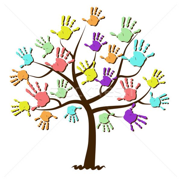 Children's hand prints united in tree Stock photo © PiXXart